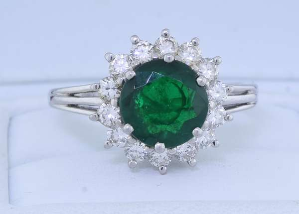EMERALD & DIAMOND PLATINUM HALO RING. This lady's platinum ring is set with an approx. 1.50 ct. very dark green emeralds, moderately-heavily included, accented by approx. .75 ct. tw. round brilliant cut diamonds, G-H-VS-SI, sz. 7 3/4, 6.5 gr. Good condition, normal wear (small nicks on emerald). - New bidders to Smiths - Payment for this lot must be made with Cash, Certified Check or Wire Transfer. NO CREDIT CARDS or Pay Pal accepted. Items will be held by Smiths until payment has cleared.