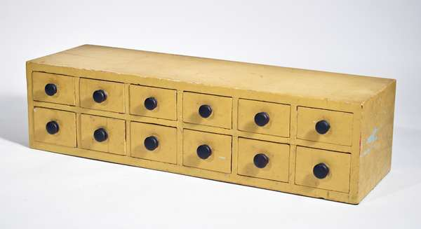 """NEW ENGLAND 12 DRAWER EARLY 19TH C. SPICE CHEST. Pine dovetailed case and drawers in older mustard paint 8""""H x 31.5""""W x 9""""D. Condition: structurally sound, paint wear to edges"""