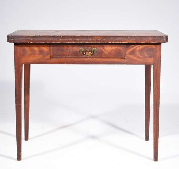 """NH COUNTRY FEDERAL GRAIN PAINTED CARD TABLE. All in original grain painted finish with a hinged fold over top, back swing leg support, drawer in the front frieze has original bale brass, and on tapered legs 29.5""""H x 36""""W x 17.5""""D (x 35.5""""D open)Condition: structurally sound, top lies flat, original drawer, no apparent repairs, in a very good state of preservation, some light paint wear commensurate with age and use"""