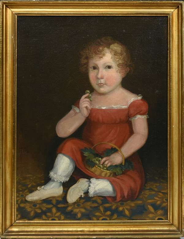 """19TH C. O/C, AMERICAN SCHOOL, YOUNG BOY IN A RED DRESS EATING GRAPES. The boy depicted seated on a patterned rug with a basket of grapes in lap and three grapes clutched in his right hand, his closed mouth and wide eyes suggest he was caught in the act of eating the grapes, perhaps without permission,  26 1/4"""" x 18 3/4"""", frame 29 1/4"""" x 21 3/4"""".  Condition: Examined under UV light. Professionally restored with masking varnish, light scattered in-painting, and craquelure throughout. The canvas re-stretched and relined with replaced stretcher."""