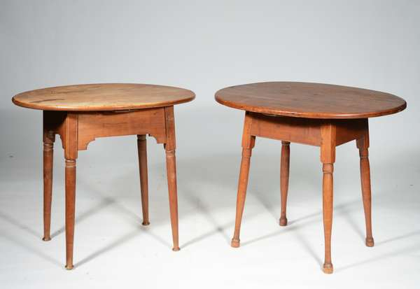 """TWO SIMILAR 18TH C. BUTTON FOOT TAVERN TABLES: oval top examples, one with 2 board maple top and maple base lighter finish 25.5""""H x 29.5""""W x 23""""D, the other with darker finish pine top and maple base, 25.5"""" x 32""""W x 24""""D. Condition both with repairs."""