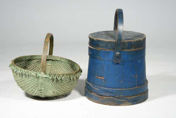 """BLUE PAINTED FIRKIN WITH GREEN HANDLED BASKET.  Firkin with lapped bands, swing handle, and old blue paint.  11""""H x 10""""W x 10""""D.  Basket buttocks form in wonderful green paint.  12""""H x 12""""W x 12""""D.  Condition: Both overall good with expected paint loss and damage."""