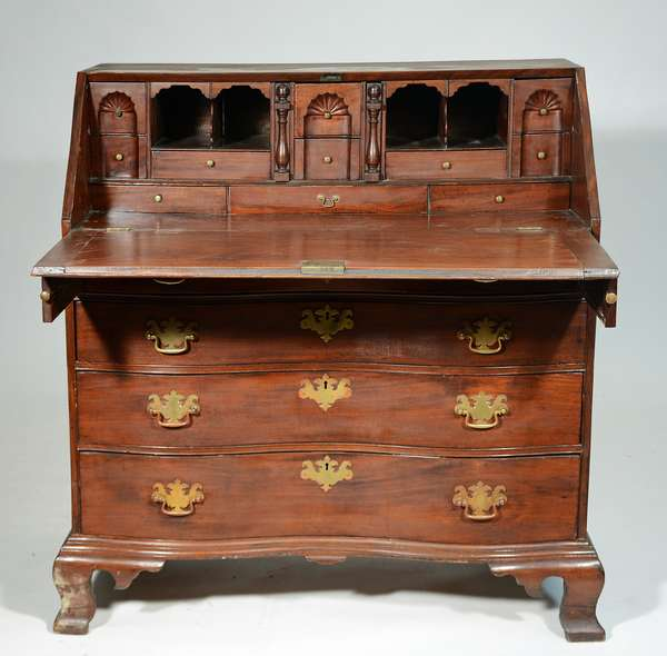 """18TH C. MA CHIPPENDALE MAHOGANY REVERSE SERPENTINE SLANT LID DESK: Boston/Salem area example,  a fine interior with 3 carved fans and blocked drawers, oxbow or reverse serpentine front on original ogee bracket feet, 44.5""""H x 42""""W x 23""""D. Condition: old finish, some shrinkage cracks and minor loss, lid hinges replaced,, replaced brass."""