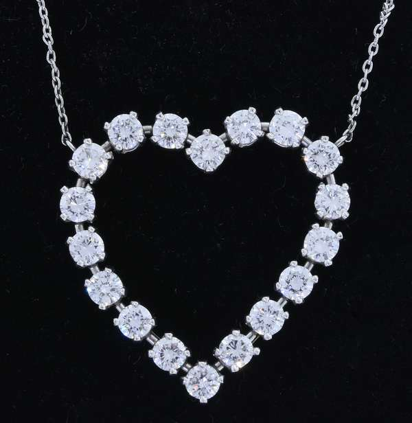 TIFFANY & CO. PLATINUM DIAMOND HEART PENDANT & CHAIN.  The 1 inch pendant is set with approx. 2.25 ct. tw. round brilliant cut diamonds, G-H-VS, very good cut, 19 inch long fine cable chain fastened by a spring ring clasp, 7.4 grams. - New bidders to Smiths - Payment for this lot must be made with Cash, Certified Check or Wire Transfer. NO CREDIT CARDS or Pay Pal accepted. Items will be held by Smiths until payment has cleared.