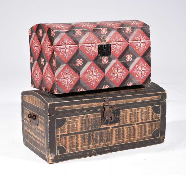 """TWO EARLY AMERICAN DOME-TOP BOXES.  A dome topped MA example with polychrome paint, colors of green, charcoal, ochre, and white pin-striping squiggle design and wallpaper liner, snipe hinges, and leather hinge straps.  9.5""""H x 20""""W x 10""""D.  Second box is a wallpaper covered, dome-top example.  Interior is lined with 1839 NY newspaper. 16""""H x 10""""W x 9.5"""" D. Condition: Wooden example has paint loss and one iron bail missing.  Wallpaper example age unknown."""