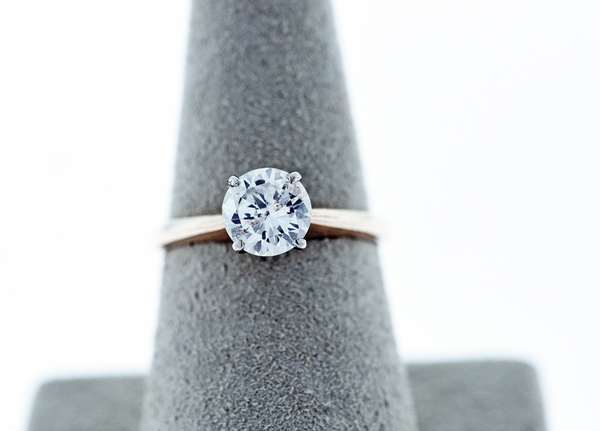 1 CT DIAMOND SOLITAIRE RING: set in 14K yellow gold 1 round cut diamond approx. 1 plus ct. SI2 clarity, ring size 6.25,. Condition: good. - New bidders to Smiths - Payment for this lot must be made with Cash, Certified Check or Wire Transfer. NO CREDIT CARDS or Pay Pal accepted. Items will be held by Smiths until payment has cleared.