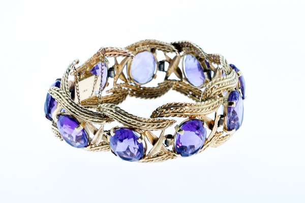 """14K AMETHYST BRACELET. Vintage large size with 9 oval faceted amethyst each approx. 7 ct. totaling approx 60 ctw. set in a twisted 14k yellow good rope design, 54 grams, 7.5""""L x 1""""W. Condition good. - New bidders to Smiths - Payment for this lot must be made with Cash, Certified Check or Wire Transfer. NO CREDIT CARDS or Pay Pal accepted. Items will be held by Smiths until payment has cleared."""