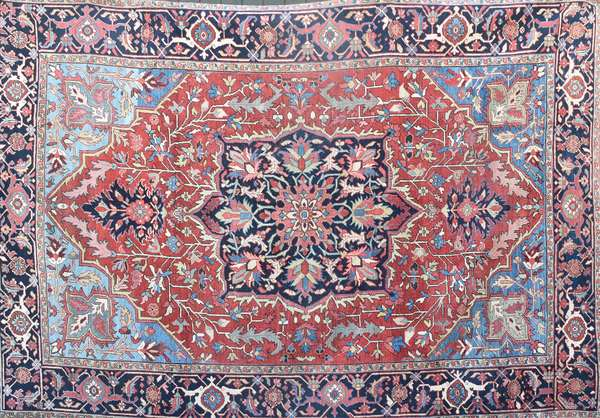"""ANTIQUE ORIENTAL HERIZ ROOMSIZE RUG. Large central floral medallion surrounded by soft blues, ivory and pink colors. 7'9"""" x 11'4"""". Condition: overall very good with a stitched repair in body, near medallion. Some area wear."""