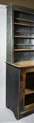 """19TH C. AMERICAN CANTED-BACK PAINTED FLOOR CUPBOARD. In two parts, painted in a blue gray paint, open top canted back with plate guards, bottom with one single raised panel door, iron latch and turned knob, 80"""" H x 20"""" D x 43 1/2"""" L. Condition: Structurally sound with repairs and replacements."""