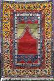 """ANTIQUE TURKISH PRAYER RUG. rich yellows, reds, blues and green. 4'6"""" x 6'9"""". Condition: showing signs of slight wear, fringe loss on both ends."""