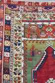 """ANTIQUE TURKISH PRAYER RUG. Ivory, green, blues and red. 4'1"""" x 5'3"""". Condition: overall good showing signs of wear commensurate for age."""